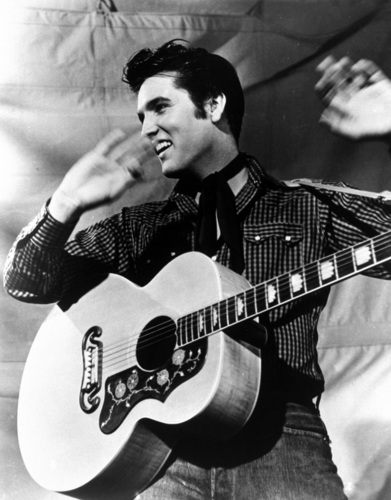 elvis presley fondo de pantalla with an acoustic guitar, a guitarist, and a snap brim hat titled Elvis Presley