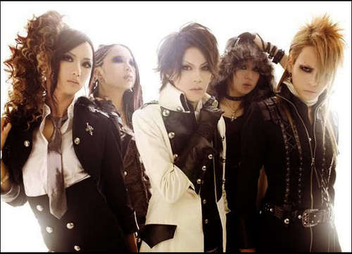 Japanese Bands wallpaper possibly with a well dressed person, a business suit, and an outerwear called Exist†Trace