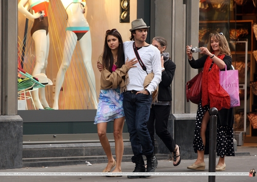 Ian Somerhalder and Nina Dobrev wallpaper with a hip boot and a sign titled Ian/Nina in Paris (HQ)ღ