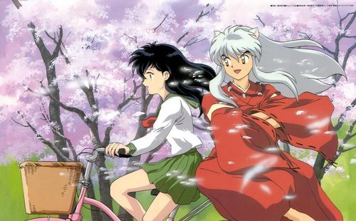 InuYasha and Kagome riding Kagome's bike