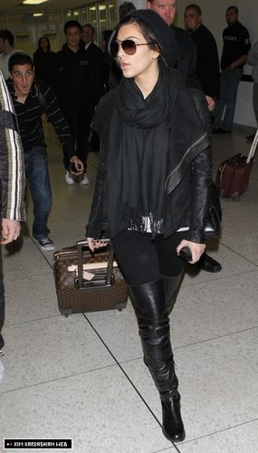 Kim is photographed in New City before arriving at LAX airport 3/28/11