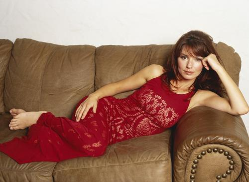 Shania Twain wallpaper probably with a divano entitled Shania Twain