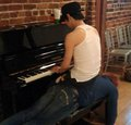 "Yoochun and his priceless piano ""seat"""
