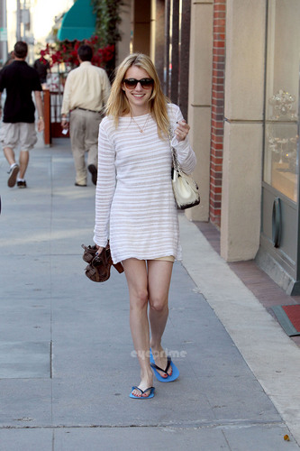 Emma Roberts carries her heels as she leaves a nail salon in Beverly Hills, May 27