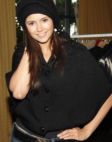 Nina Dobrev fond d'écran probably with an outerwear and a hip boot titled Nina Dobrev