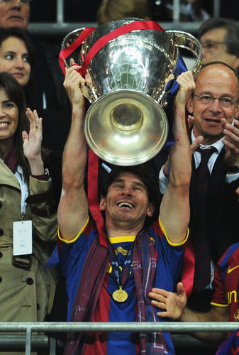 Lionel Andres Messi wallpaper called Barcelona Return Home Victorious With Champions League Trophy  (Lionel Messi)