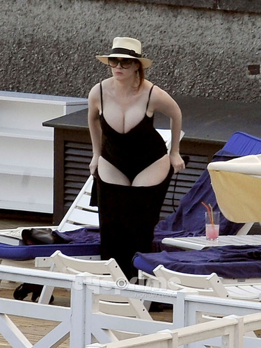 Christina Hendricks wallpaper entitled Christina Hendricks relaxing by the Hotel Pool in Lake Como, Italy.