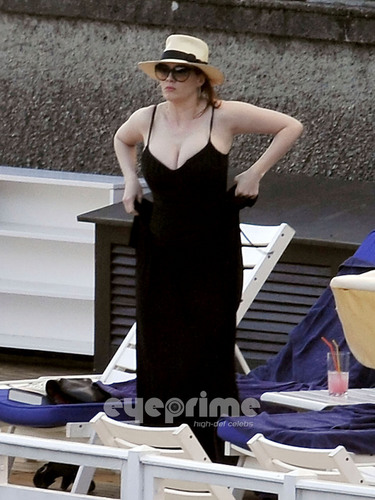 Christina Hendricks relaxing da the Hotel Pool in Lake Como, Italy.