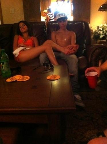 Justin rubbing Selena's feet!