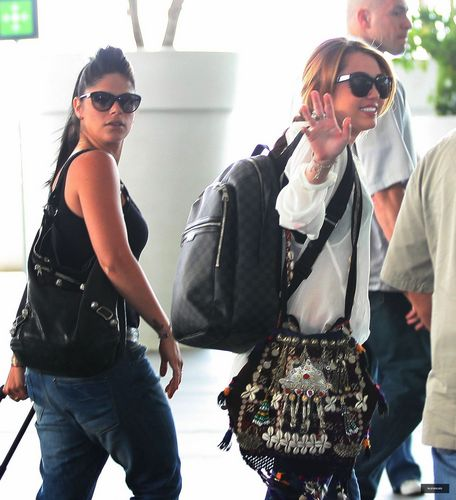 Miley - At the Airport in Mexico - May 27, 2011