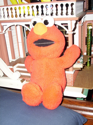 Sesame Street wallpaper entitled The Original Tickle Me Elmo doll from Tyco