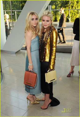 Mary-Kate & Ashley Olsen wallpaper possibly containing a street, a business suit, and a well dressed person titled  2011 CFDA Fashion Awards