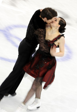 Tessa Virtue & Scott Moir wallpaper probably containing a well dressed person and a hip boot called  CD 2010 Vancouver Olympics (Tango Romantica)
