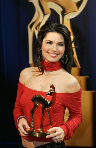 Shania Twain wallpaper probably with a playsuit, a hip boot, and a top titled Bambi Awards
