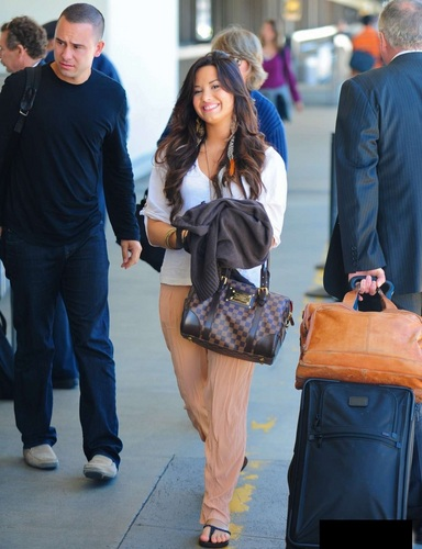 Demi - Departs LAX Airport In Los Angeles - June 06, 2011