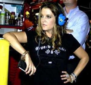 Lisa Marie Presley fond d'écran containing a workwear, vêtements de travail titled L I S A