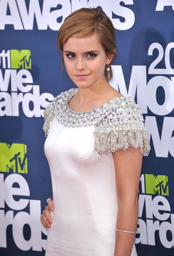 Emma Watson wolpeyper probably containing a kaktel dress, a frock, and a damit called MTV Movie Awards - June 5th, 2011