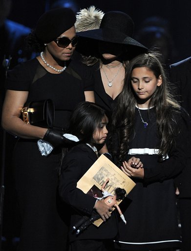 Paris and Blanket in the funeral. Paris holding Blanket's hand. This is so sad :/
