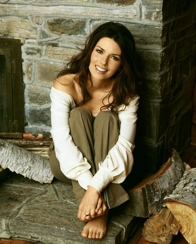Shania Twain wallpaper containing an outerwear, a hip boot, and a street called Shania Twain