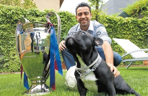 Xavi and the CL trophy!