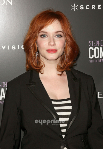 Christina Hendricks achtergrond possibly with a well dressed person, a business suit, and a portrait titled 'The Company' New York Premiere