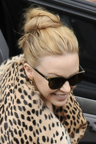 "Kylie Minogue wears a leopard print coat to greet her Sydney fans before her ""Aphrodite"" show"