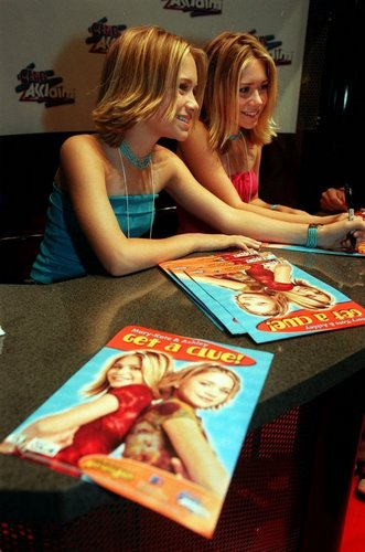 Mary-Kate & Ashley Olsen wallpaper containing a sign called 2000 - E3 Convention