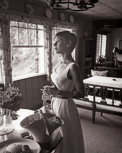 Audrey in 1957 pictured gazing out the kitchen window of the Villa Bethania in Bürgenstock
