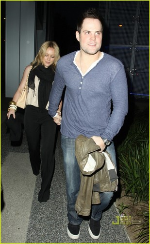 Hilary Duff & Mike Comrie wallpaper probably containing a hip boot, a well dressed person, and an outerwear entitled Hilary Duff & Mike Comrie