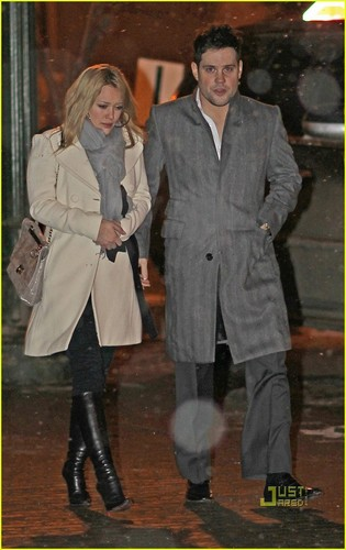 Hilary Duff & Mike Comrie wallpaper with a well dressed person, a business suit, and a trench cappotto called Hilary Duff & Mike Comrie