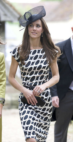 Kate Middleton and sister Pippa Middleton attend the wedding of Sam Waley-Cohen