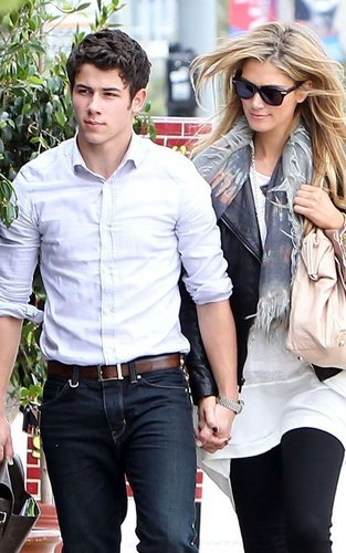 Nick Jonas پیپر وال containing a business suit and sunglasses called Nick Jonas & Delta Goodrem: Holding Hands at Henry's Hat (06.12.2011) !!!
