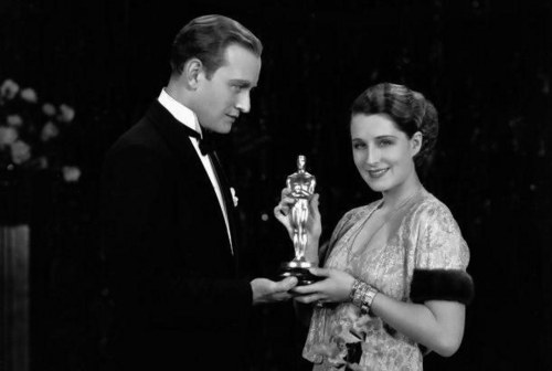 Norma Shearer accepts her Oscar from actor Conrad Nagel at the award ceremonies held in 1931