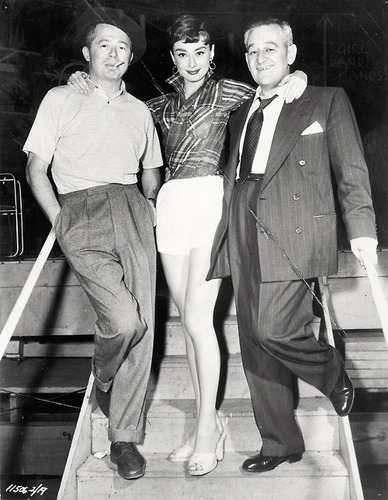 1954, during the filming of Sabrina: Audrey and director Bill Wilder and William Holden