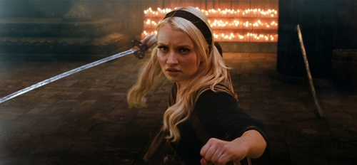 Emily Browning kertas dinding probably with a concert, a fire, and a sign entitled Baby Doll