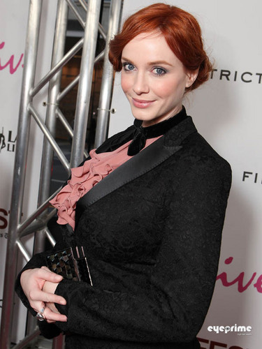 "Christina Hendricks wallpaper probably containing a business suit and a well dressed person called Christina Hendricks arrives at the ""Drive"" Gala Premiere in L.A, June 17"