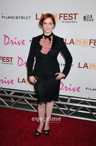 "Christina Hendricks wallpaper containing a business suit and a well dressed person entitled Christina Hendricks arrives at the ""Drive"" Gala Premiere in L.A, June 17"