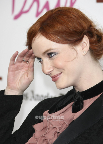 "क्रिसटीना हेंड्रिक्स वॉलपेपर probably containing a business suit, a well dressed person, and a portrait entitled Christina Hendricks arrives at the ""Drive"" Gala Premiere in L.A, June 17"