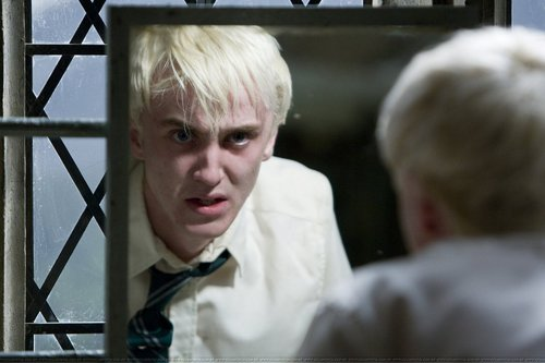 Tom Felton wallpaper with a chainlink fence titled Half Blood Prince