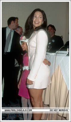 Selena (the movie) wallpaper probably containing bare legs, hosiery, and a chemise called selena-press-conference-1996