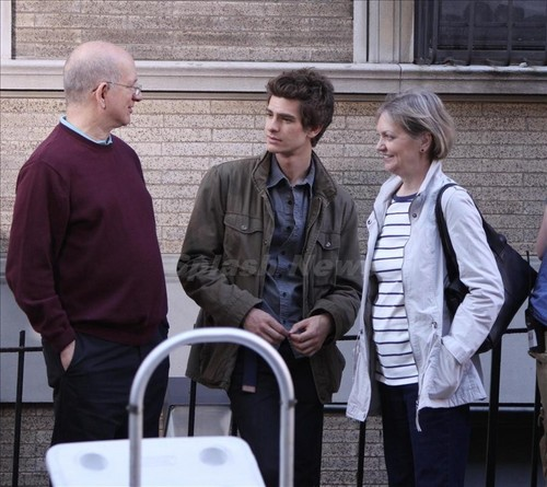 Andrew with his parents.