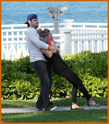 Hilary Duff & Mike Comrie wallpaper containing a picket fence and a business suit called Hilary Duff & Mike Comrie