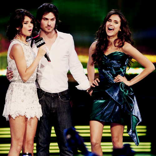 Ian Somerhalder and Nina Dobrev wallpaper possibly containing a cocktail dress, a dress, and a hip boot titled Ian's sneaky hand!