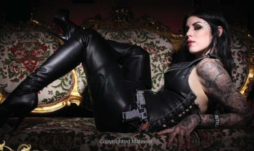 Kat Von D wallpaper with a breastplate, a hip boot, and an armor plate entitled KAT