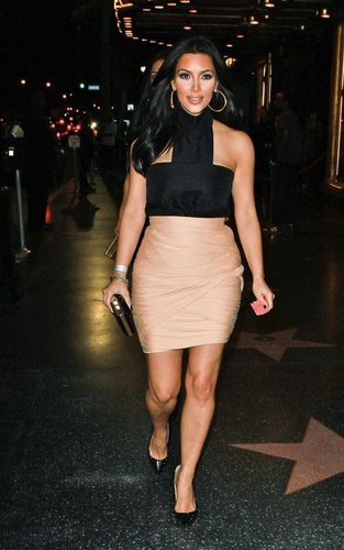 Kim Kardashian wallpaper probably containing bare legs entitled Kim turning up for Justin Bieber's manager Scooter Braun's birthday bash in Los Angeles on Saturday
