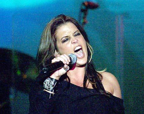 Lisa Marie Presley wolpeyper with a konsiyerto and a guitarist titled LMP