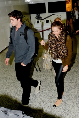 Miley - At Sydney Airport with Liam in Australia - June 20, 2011