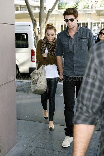 Miley Cyrus karatasi la kupamba ukuta containing a street, a business suit, and a carriageway titled Miley - Out for lunch with Liam in Sydney, Australia [20th June 2011]