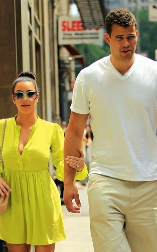 Kim Kardashian wallpaper probably with a street and a wicket called  Kim Kardashian and Kris Humphries in NYC. (June 25)