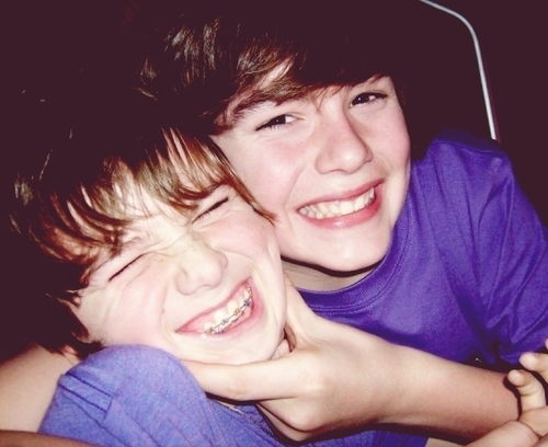 Chaz is makin Christian do a baby face! How cute?